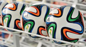 HERZOGENAURACH, GERMANY - DECEMBER 06:  Brazuca match balls for the FIFA World Cup 2014 lie in a rack on December 6, 2013 in Scheinfeld near Herzogenaurach, Germany. Brazuca is the Official Match Ball for the FIFA World Cup 2014 Brazil.  (Photo by Lennart Preiss/Getty Images for adidas)