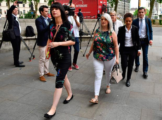 """Northern Ireland resident and campaigner Sarah Ewart (4R), who after having been diagnosed with a fatal foetal abnormality in 2013 travelled to England for a termination, arrives at the Supreme Court in London on June 7, 2018. Britain's Supreme Court on Thursday said it could not rule on an appeal against Northern Ireland's strict abortion laws, but that it would have declared them incompatible with human rights laws otherwise. By a majority decision, the justices said that the Northern Ireland Human Rights Commission (NIHRC), which brought the appeal, did not have the power to """"institute abstract proceedings of this nature"""". / AFP PHOTO / Ben STANSALLBEN STANSALL/AFP/Getty Images"""
