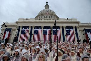 Members of the Mormon Tabernacle Choir wait below the Capitol dome in Washington, DC, on January 20, 2017, before the swearing-in ceremony of US President-elect Donald Trump. / AFP PHOTO / Brendan SMIALOWSKIBRENDAN SMIALOWSKI/AFP/Getty Images