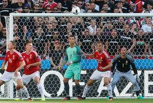 Portugal's Cristiano Ronaldo, center, eyes the ball during the Euro 2016 Group F soccer match between Hungary and Portugal at the Grand Stade in Decines-Charpieu, near Lyon, France, Wednesday, June 22, 2016. (AP Photo/Darko Bandic)