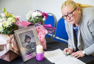 Sinn Fein for Belfast City Council Emma Groves signs the book of condolence at Connolly House, Andersonstown, Belfast, following the death of Northern Ireland's former deputy first minister and ex-IRA commander Martin McGuinness aged 66.  Liam McBurney/PA Wire