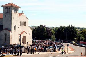 Mourners gather at Our Lady of Perpetual Succour in Foxrock, Dublin, for the funeral of Eimear Walsh who died when a balcony collapsed in the college town of Berkeley, California. PRESS ASSOCIATION Photo. Picture date: Tuesday June 23, 2015. See PA story FUNERAL Balcony. Photo credit should read: Brian Lawless/PA Wire