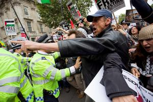 Pro-Palestinian demonstrators scuffle with police as they protest against a planned visit of Israeli Prime Minister Benjamin Netanyahu outside the gates of Downing Street in London on September 9, 2015. Over 100 pro-Israeli demonstrators and hundreds of pro-Palestinian activists rallied in front of Downing Street in London ahead of a planned visit of Israeli Prime Minister Benjamin Netanyahu. Netanyahu visits Britain this week for talks with his counterpart David Cameron as the right-wing Israeli leader faces diplomatic pressure over West Bank settlements and stalled peace efforts. AFP PHOTO / JUSTIN TALLISJUSTIN TALLIS/AFP/Getty Images