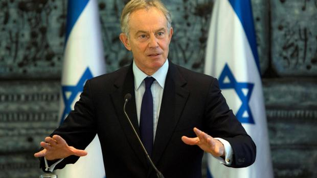 Former British Prime Minister and Mideast Envoy Tony Blair, gestures as he speaks during joint statements with Israel's President Shimon Peres at the President's residence in Jerusalem, Tuesday, July 15, 2014. The Israeli military says Gaza militants have fired three rockets that caused no casualties or damage near the southern Israeli city of Ashkelon, since the deadline passed for the start of a cease-fire proposed by Egypt. (AP Photo/Sebastian Scheiner)