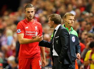 LIVERPOOL, ENGLAND - AUGUST 17:  Jordan Henderson of Liverpool shakes hands with Brendan Rodgers manager of Liverpool as he is substituted during the Barclays Premier League match between Liverpool and A.F.C. Bournemouth at Anfield on August 17, 2015 in Liverpool, United Kingdom.  (Photo by Alex Livesey/Getty Images)