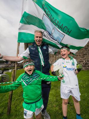 Robbie Fitzpatrick and his sons Matteo and Lorenzo are looking forward to watching Fermanagh take on Donegal in Clones on Sunday.  Picture: Ronan McGrade