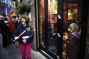 A clown entertains people in the cathedral quarter in Belfast during the culture night. Picture by Peter Morrison