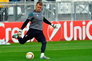 Liverpool's Belgian goalkeeper Simon Mignolet shoots the ball during the warm up of the UEFA Europa League Group B football match Bordeaux vs Liverpool on September 17, 2015 at the Matmut Atlantique stadium in Bordeaux. AFP PHOTO / NICOLAS TUCATNICOLAS TUCAT/AFP/Getty Images