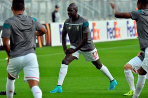 Liverpool's French defender Mamadou Sakho stretches during the warm up of the UEFA Europa League Group B football match Bordeaux vs Liverpool on September 17, 2015 at the Matmut Atlantique stadium in Bordeaux. AFP PHOTO / NICOLAS TUCATNICOLAS TUCAT/AFP/Getty Images
