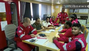 Various crew members of the British-flagged tanker Stena Impero, that was seized by Tehran in the Strait of Hormuz on Friday, during a meeting (IRIB News Agency/AP/PA)