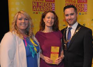 Feature Journalist of the Year Gail Walker (centre) accepte her award from Samantha Livingstone, Massive PR and Gary McKeown, CIPR