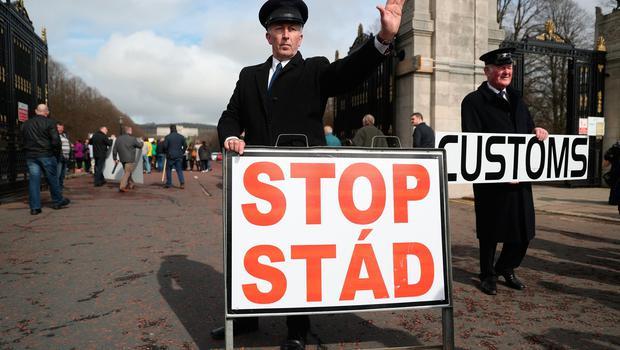 Anti-Brexit campaigners dressed as customs officers, protest outside Stormont in Belfast, as Prime Minister Theresa May triggers Article 50, starting the process that will see Britain leave the EU. Brian Lawless/PA Wire
