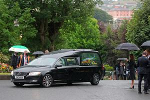 The hearse carrying the body of John Hume arrives at St Eugene's Cathedral in Londonderry for his funeral. Pic: Niall Carson/PA Wire
