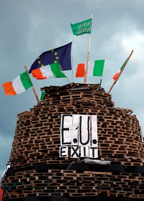 """A  huge bonfire in Tigers Bay area of  Belfast before it is lit on the """"Eleventh night"""" to usher in the Twelfth commemorations. PA"""