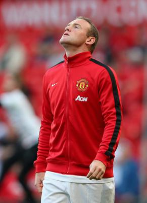 MANCHESTER, ENGLAND - AUGUST 26:  Wayne Rooney of Manchester United looks on prior to the Barclays Premier League match between Manchester United and Chelsea at Old Trafford on August 26, 2013 in Manchester, England.  (Photo by Alex Livesey/Getty Images)