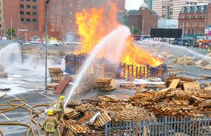 Firefighters at the scene of the Sandyrow bonfire as it was set alight early on June 25 2015. Picture - Kevin Scott / Presseye
