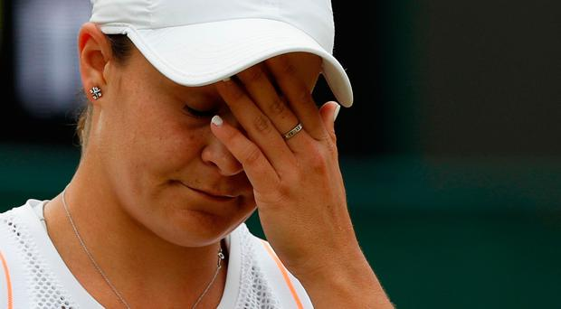 Australia's Ashleigh Barty reacts as she is knocked out of Wimbledon by unseeded American Alison Riske.
