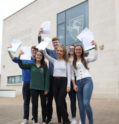 PACEMAKER PRESS 15/8/2019 A Level Students who achieved 3A/A*s from Grosvenor Grammar School. Owen Hamilton, James Magrath, Leah McCoy, Annie Patterson, Lisa Purdy. There has been a rise in the proportion of top A-level grades awarded to pupils in Northern Ireland. About 28,000 students received their A-level and AS-level results on Thursday morning. Just over 30% of entries were awarded A* or A grades, a rise of half a per cent on 2018. Photo by Laura Davison/Pacemaker Press