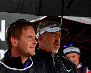 NEWCASTLE, NORTHERN IRELAND - MAY 29:  Darren Clarke of Northern Ireland (R) looks on on the first tee under an umbrella during the second round of the Dubai Duty Free Irish Open hosted by the Rory Foundation at Royal County Down Golf Club on May 29, 2015 in Newcastle, Northern Ireland. (Photo by Mark Runnacles/Getty Images)