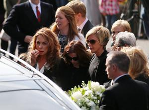 Christine Anderson (left) arrives for the funeral of her husband BBC broadcaster Gerry Anderson at St Eugene's Cathedral in Londonderry. PRESS ASSOCIATION Photo. Picture date: Sunday August 24, 2014. See PA story FUNERAL Anderson. Photo credit should read: Niall Carson/PA Wire