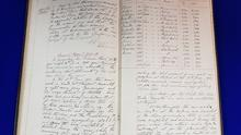The handwritten Minute Book from Harland & Wolff shipyard that references RMS Titanic