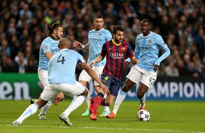 Barcelona's Francesc Fabregas runs at the Manchester City defence during the UEFA Champions League, Round of 16 match at the Etihad Stadium, Manchester. PRESS ASSOCIATION Photo. Picture date: Tuesday February 18, 2014. See PA story SOCCER Man City. Photo credit should read: Peter Byrne/PA Wire