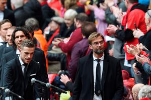 Liverpool's German manager Jurgen Klopp (R) arrives with his players to attend a memorial service at Anfield in Liverpool, north west Engand on April 15, 2016, on the 27th anniversary of the Hillsborough Disaster. 96 Liverpool supporters died at the 1989 FA Cup semi-final between Liverpool and Nottingham Forest at the Hillsborough football ground in Sheffield, northern England. 2016 will be the final year a memorial service is held at Anfield. / AFP PHOTO / PAUL ELLISPAUL ELLIS/AFP/Getty Images