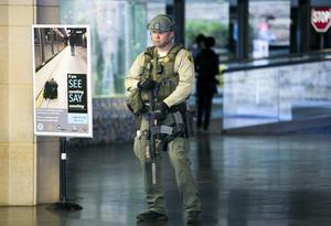 A Los Angeles Sheriffs Counter Terrorism Unit officer carries an AR-15 assault rifle, as he patrols the entrance to Union Station in Los Angeles Monday, April 15, 2013. The city increased security following bomb explosions in Boston that killed two people and injured more than 80 near the crowded finish line of the Boston Marathon. (AP Photo/Damian Dovarganes)