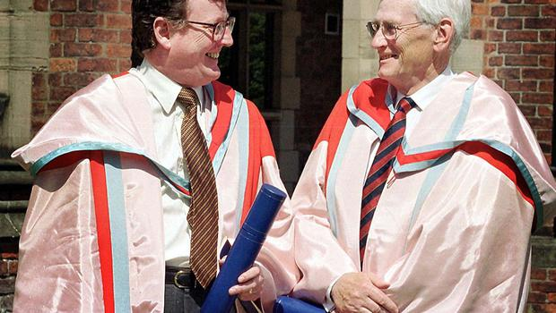 PACEMAKER  BELFAST 9/7/99 First and Deputy first ministers David Trimble and Seamus Mallon share a joke and a laugh as they both graduated from Queens University in Belfast this afternoon, both recieved houourary docterates for their work in the Peace Process.