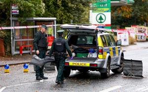 Forensic officers at the scene of the fatal crash on the Malone Road in Belfast. Pic Kevin Scott