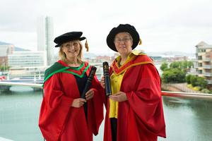 Receiving honorary gdegrees from Ulster University this morning are Sandra Peake and Claire Keatinge. Sandra Peake, CEO of WAVE Trauma Centre, received the honorary degree of Doctor of Science (DSc) for distinguished services to the Northern Ireland community. Claire Keatinge, Northern Irelands first ever Commissioner for Older People, received the honorary degree of Doctor of Laws (LLD) for distinguished services to the community.  (Photo: Nigel McDowell/Ulster University)