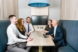 KPMG's Johnny Hanna (right) pictured with staff at the firm's Belfast offices