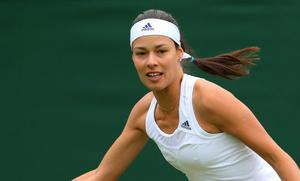 LONDON, ENGLAND - JUNE 24:  Ana Ivanovic of Serbia plays a forehand during her Women's Singles match against Virginie Razzano of France on day one of the Wimbledon Lawn Tennis Championships at the All England Lawn Tennis and Croquet Club on June 24, 2013 in London, England.  (Photo by Julian Finney/Getty Images)