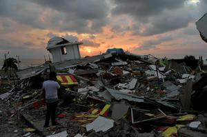 TOPSHOT - The sun sets in one of Ecuador's worst-hit towns, Pedernales, a day after a 7.8-magnitude quake hit the country, on April 17, 2016. The toll from the big earthquake in Ecuador rose on Sunday to 246 dead and 2,527 people injured, the country's vice president said. / AFP PHOTO / RODRIGO BUENDIARODRIGO BUENDIA/AFP/Getty Images