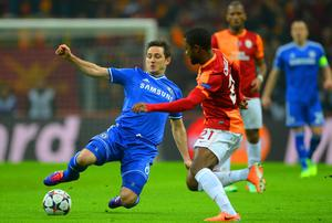 Frank Lampard of Chelsea is closed down by Aurelien Chedjou of Galatasaray during the UEFA Champions League Round of 16 first leg match between Galatasaray AS and Chelsea at Ali Sami Yen Arena on February 26, 2014 in Istanbul, Turkey.  (Photo by Michael Regan/Getty Images)