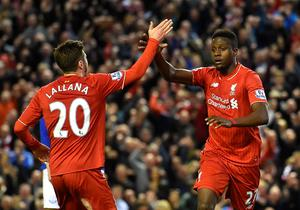 Liverpool's Belgian striker Divock Origi (R) celebrates with Liverpool's English midfielder Adam Lallana after scoring during the English Premier League football match between Liverpool and Everton at Anfield in Liverpool, north west England on April 20, 2016. AFP/Getty Images