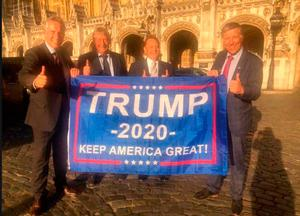 Support: DUP MPs Ian Paisley (left), Sammy Wilson (second left) and Paul Girvan (right) fly the flag for Donald Trump