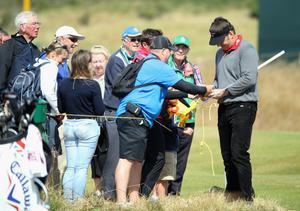 GULLANE, SCOTLAND - JULY 15:  Sir Nick Faldo of England signs autographs ahead of the 142nd Open Championship at Muirfield on July 15, 2013 in Gullane, Scotland.  (Photo by Andy Lyons/Getty Images)