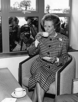 1987:  (FILE PHOTO)  Baroness Margaret Thatcher, 85, Britain's Prime Minister from 1979 to 1990, Reports on April 8, 2013 state that Baroness Thatcher has died following a stroke.. Please refer to the following profile on Getty Images Archival for further imagery.  http://www.gettyimages.com/Search/Search.aspx?EventId=108930459&EditorialProduct=Archival   British Conservative Prime Minister, Margaret Thatcher, enjoys a cup of tea at the opening of the South Mimms Motorway service area, watched by the press on June 6, 1987 in England.  (Photo by Keystone/Getty Images)
