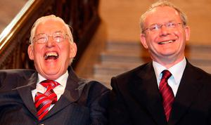 Northern Ireland's First Minister Ian Paisley and Deputy First Minister Martin McGuinness smile after being sworn in as ministers of the Northern Ireland Assembly, at Stormont Parliamentary Building, Belfast, Northern Ireland, Tuesday May 8, 2007. The unopposed election of Democratic Unionist Party chief Paisley and Irish Republican Army veteran McGuinness to lead a new 12-member administration heralded an astonishing new era for Northern Ireland following decades of bloodshed and political stalemate that left 3,700 dead. (AP Photo/Paul Faith, Pool)