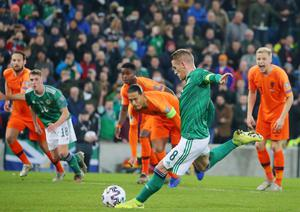 Press Eye - Belfast - Northern Ireland - 16th November 2019  UEFA EURO 2020 Qualifier Group C.  Northern Ireland Vs Netherlands at the National Stadium at Windsor Park, Belfast.   Northern Ireland captain Steven Davis takes a penalty which he fails to score at NetherlandsÕ captain Virgil van Dijk looks on.    Picture by Jonathan Porter/PressEye