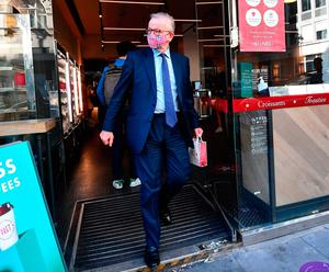 Stand-off: Michael Gove leaves a cafe in Westminster ahead of the meeting