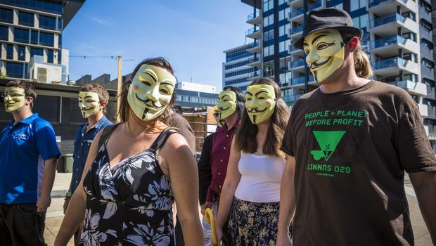 Anonymous activists meet in inner Brisbane wearing Guy Fawkes masks, an item that has been banned during the G20 Summit, ahead of the Peoples' March on November 14, 2014 in Brisbane, Australia. (Photo by Glenn Hunt/Getty Images)