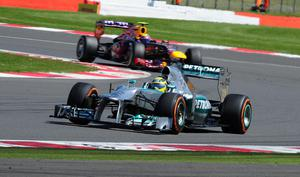 Mercedes' Nico Rosberg on his way to victory followed by Red Bull's Mark Webber during the 2013 Santander British Grand Prix at Silverstone Circuit, Towcester. PRESS ASSOCIATION Photo. Picture date: Sunday June 30, 2013. See PA story AUTO British. Photo credit should read: Anna Gowthorpe/PA Wire. RESTRICTIONS: Use subject to restrictions. Editorial use in print media and internet only. No mobile or TV. Commercial use with prior consent. Call +44 (0)1158 447447 for further information.