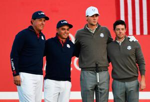 CHASKA, MN - OCTOBER 01: Phil Mickelson and Rickie Fowler of the United States pose on the first tee with Thomas Pieters and Rory McIlroy of Europe during morning foursome matches of the 2016 Ryder Cup at Hazeltine National Golf Club on October 1, 2016 in Chaska, Minnesota.  (Photo by Ross Kinnaird/Getty Images)