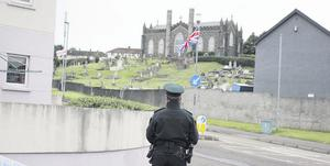 Police cordon off the entrance to St John's Church graveyard in Coleraine after two handguns were reportedly found