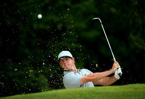 LOUISVILLE, KY - AUGUST 08:  Rory McIlroy of Northern Ireland hits out of the bunker on the third hole during the second round of the 96th PGA Championship at Valhalla Golf Club on August 8, 2014 in Louisville, Kentucky.  (Photo by Andrew Redington/Getty Images) *** BESTPIX ***