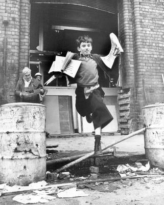 Belfast Telegraph: Explosion. Building. 15/9/1976. No stopping the 'Tele' from hitting the streets, despite having been rocked by an explosion.  Here newsboy Joe Officer makes his way through the rubble to sell Belfast Telegraph's.