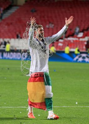 Real Madrid's Sergio Ramos celebrates with a piece of the goal net after the UEFA Champions League Final at at the Estadio da Luiz, Lisbon, Portugal. PRESS ASSOCIATION Photo. Picture date: Saturday May 24, 2014. See PA story SOCCER Final. Photo credit should read: Nick Potts/PA Wire. RESTRICTIONS: Editorial use only. No commercial use. No video emulation. No false commercial association.