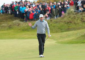NEWCASTLE, NORTHERN IRELAND - MAY 29:  Padraig Harrington of Ireland acknowledges the crowd on the 18th green during the Second Round of the Dubai Duty Free Irish Open Hosted by the Rory Foundation at Royal County Down Golf Club on May 29, 2015 in Newcastle, Northern Ireland.  (Photo by Andrew Redington/Getty Images)